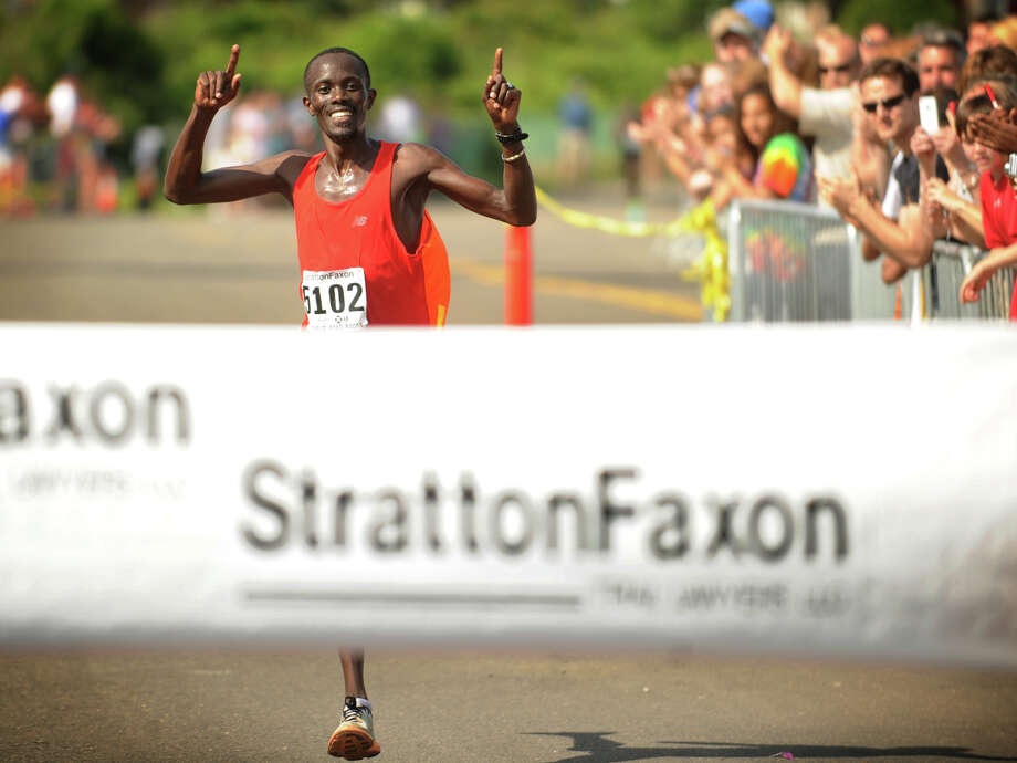 Men's winner Eric Chirchir of Kenya approaches the finish line of the Fairfield Half Marathon in Fairfield, Conn. on Sunday, June 23, 2013. Chirchir finished the race in 1:05:58. Photo: Brian A. Pounds / Connecticut Post