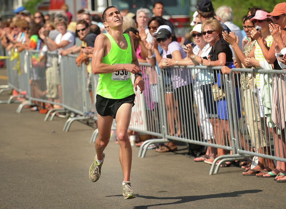 Matt Klein of Trumbull makes his way to the finish and a fourteenth place overall in the Fairfield Half Marathon in Fairfield, Conn. on Sunday, June 23, 2013. Klein's time was 1:13:02. Photo: Brian A. Pounds / Connecticut Post
