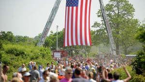Hundreds head for the finish of the Fairfield Half Marathon in Fairfield, Conn. on Sunday, June 23, 2013.