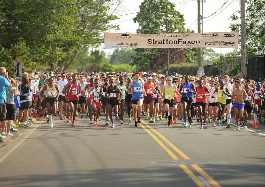 The mass start of the Fairfield Half Marathon on Fairfield Beach Road in Fairfield, Conn. on Sunday, June 23, 2013. Photo: Brian A. Pounds / Connecticut Post