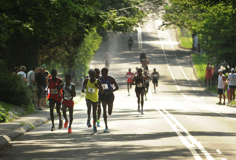 The lead runners in the Fairfield Half Marathon make their way up Old Field Road in Fairfield, Conn. on Sunday, June 23, 2013. Photo: Brian A. Pounds / Connecticut Post