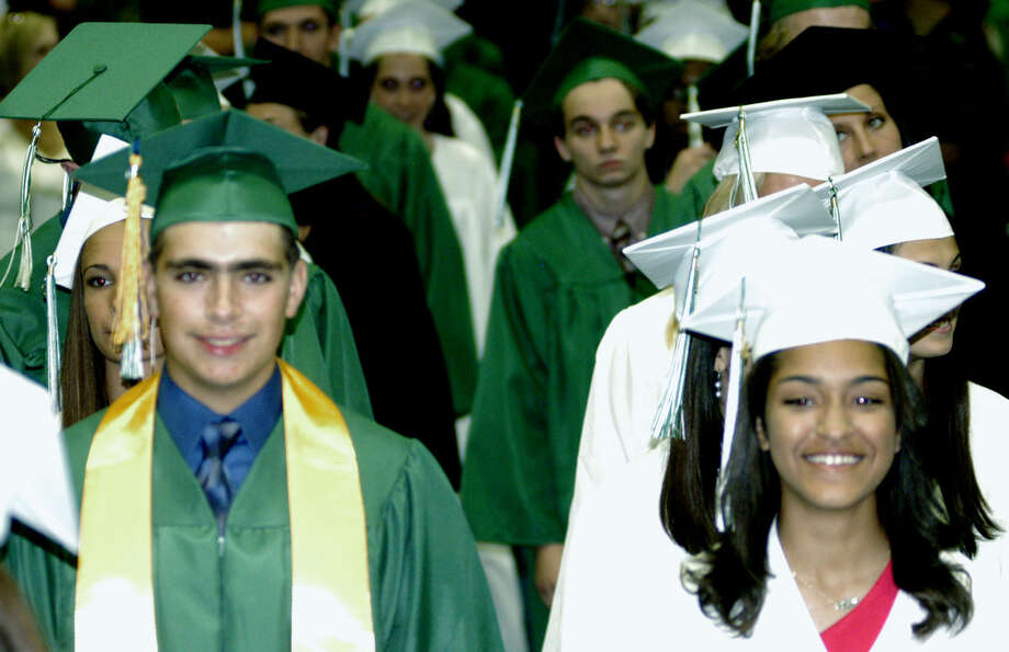 The Class of 2013 experiences the processional during New Milford High School's commencement exercises at the O'Neill Center on the campus of Western Connecticut State University in Danbury. June 22, 2013 Photo: Norm Cummings