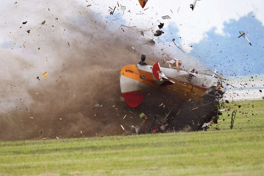 A stunt plane with a wing walker crashes during a performance at the Vectren Air Show, Saturday, June 22, 2013, in Dayton, Ohio. The crash killed the pilot and the wing walker instantly, authorities said. Photo: AP