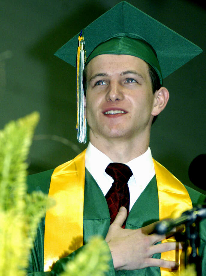Class of 2013 vice president Daniel Fay leads everyone in the Pledge of Allegiance during New Milford High School's commencement exercises at the O'Neill Center on the campus of Western Connecticut State University in Danbury. June 22, 2013 Photo: Norm Cummings