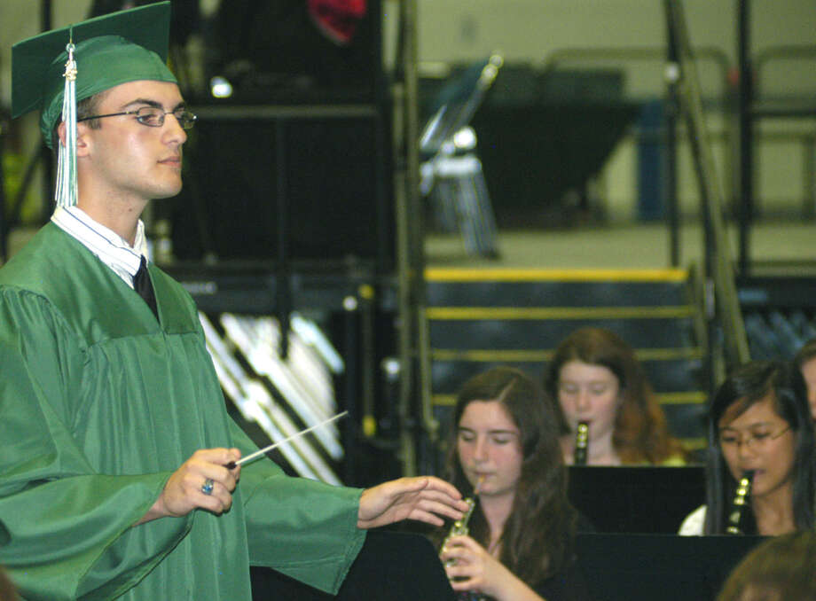 Class of 2013 member Ryan DelMastro leads the NMHS orchestra in their performance of The Star Spangled Banner during New Milford High School's commencement exercises at the O'Neill Center on the campus of Western Connecticut State University in Danbury. June 22, 2013 Photo: Norm Cummings