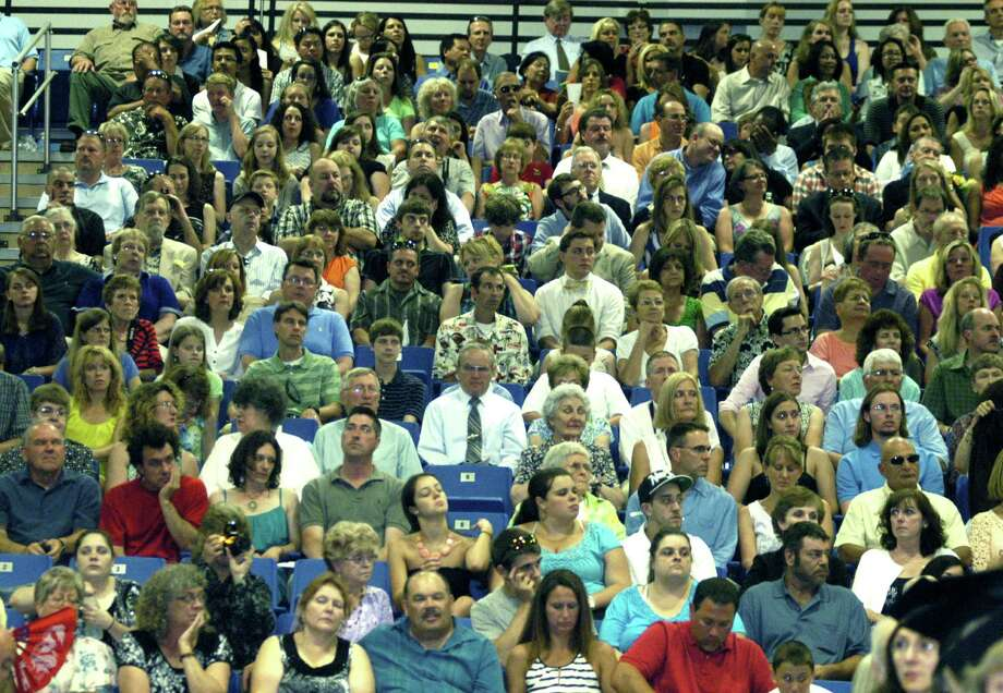 A portion of the crowd of about 4,000 awaits the start of New Milford High School's commencement exercises at the O'Neill Center on the campus of Western Connecticut State University in Danbury. June 22, 2013 Photo: Norm Cummings