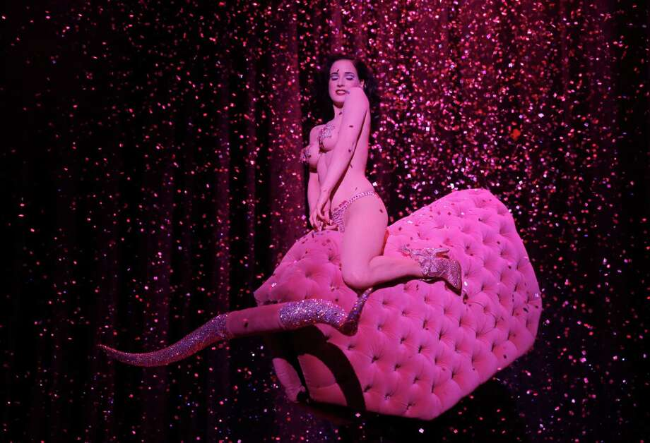 "Dita Von Teese performs onstage at ""Burlesque: Strip Strip Hooray!"" Starring Dita Von Teese on Wednesday, June 19, 2013, in Los Angeles. Photo: AP"