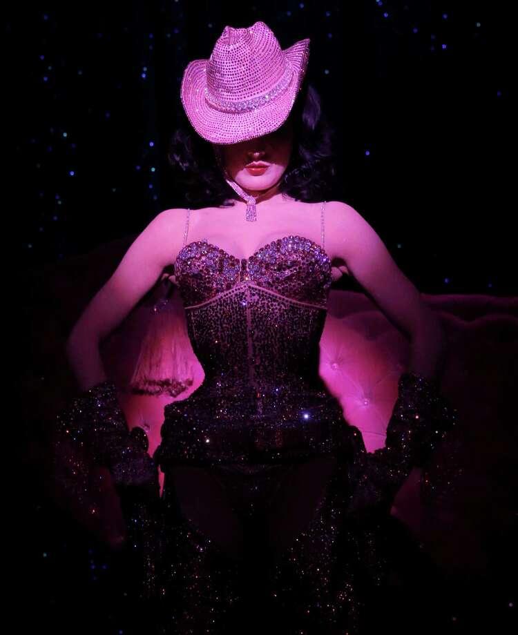 """Dita Von Teese performs onstage at """"Burlesque: Strip Strip Hooray!"""" Starring Dita Von Teese on Wednesday, June 19, 2013, in Los Angeles. Photo: AP"""