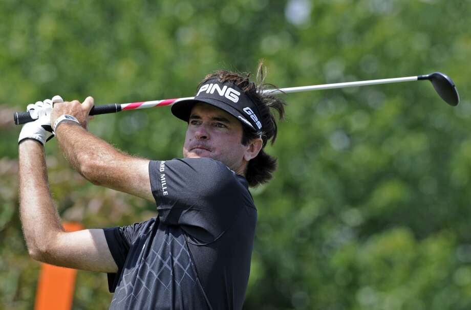 Bubba Watson watches his drive on the second hole during the final round of the Travelers Championship golf tournament in Cromwell, Conn., Sunday, June 23, 2013. (AP Photo/Fred Beckham)