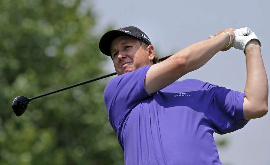 J.J. Henry watches his drive on the second hole during the final round of the Travelers Championship golf tournament in Cromwell, Conn., Sunday, June 23, 2013. (AP Photo/Fred Beckham)