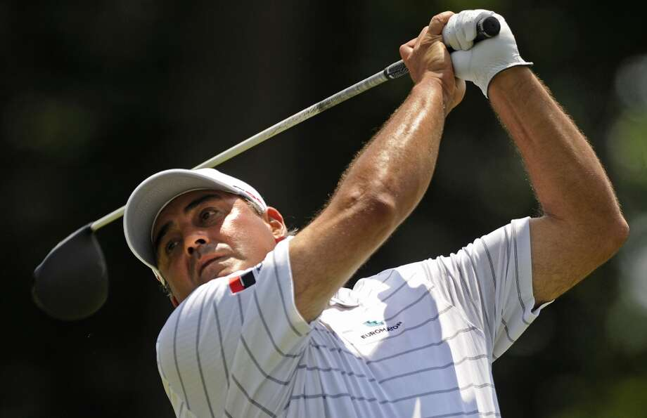 Angel Cabrera, of Argentina, watches his drive on the 18th hole during the final round of the Travelers Championship golf tournament in Cromwell, Conn., Sunday, June 23, 2013. Cabrera bogeyed the hole. (AP Photo/Fred Beckham)