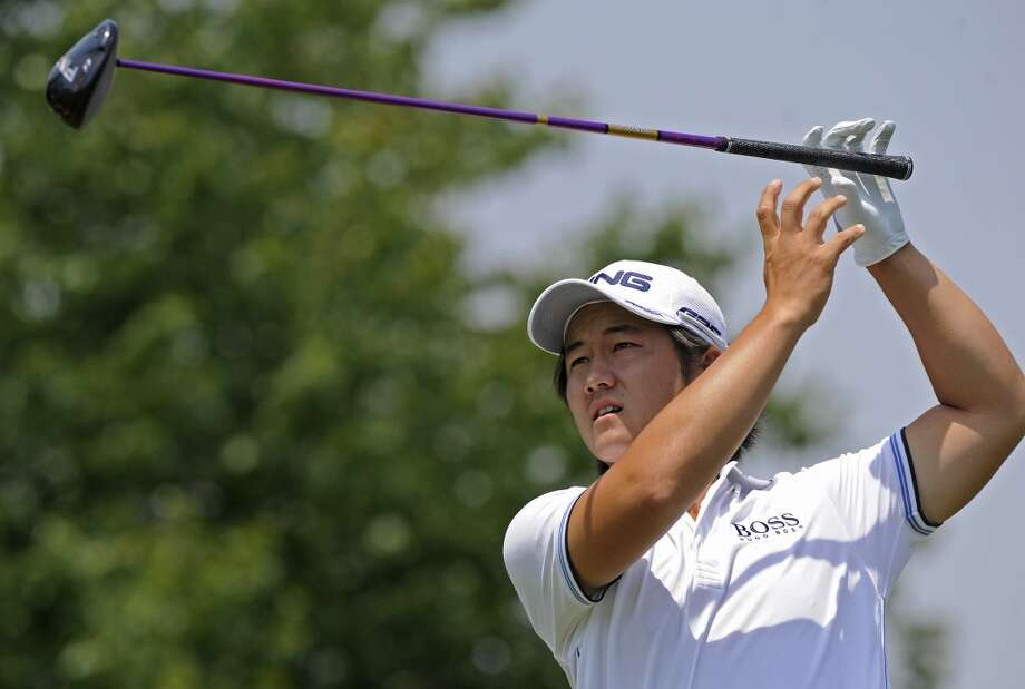 Richard H. Lee watches his drive on the second hole during the final round of the Travelers Championship golf tournament in Cromwell, Conn., Sunday, June 23, 2013. (AP Photo/Fred Beckham)