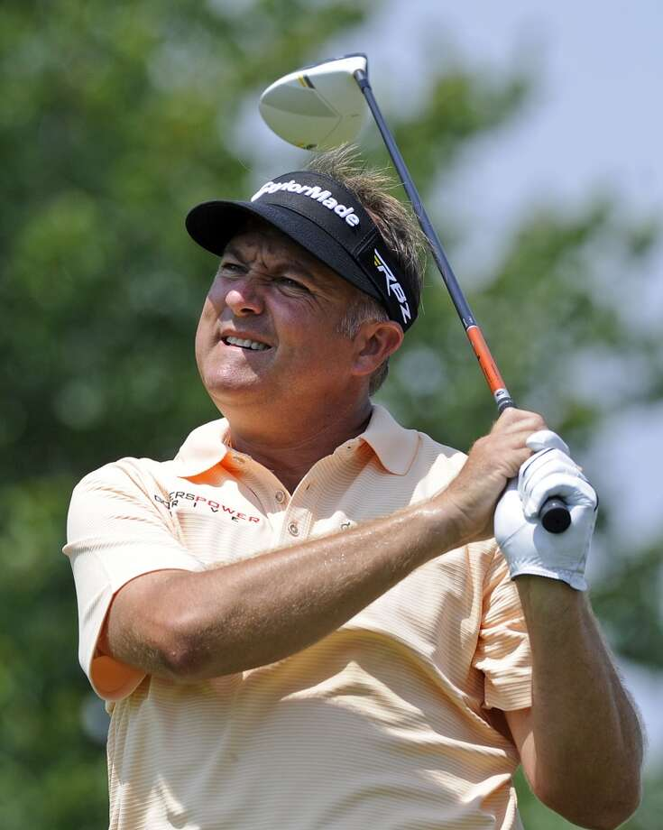 Ken Duke watches his tee shot on the second hole during the final round of the Travelers Championship golf tournament in Cromwell, Conn., Sunday, June 23, 2013. (AP Photo/Fred Beckham)