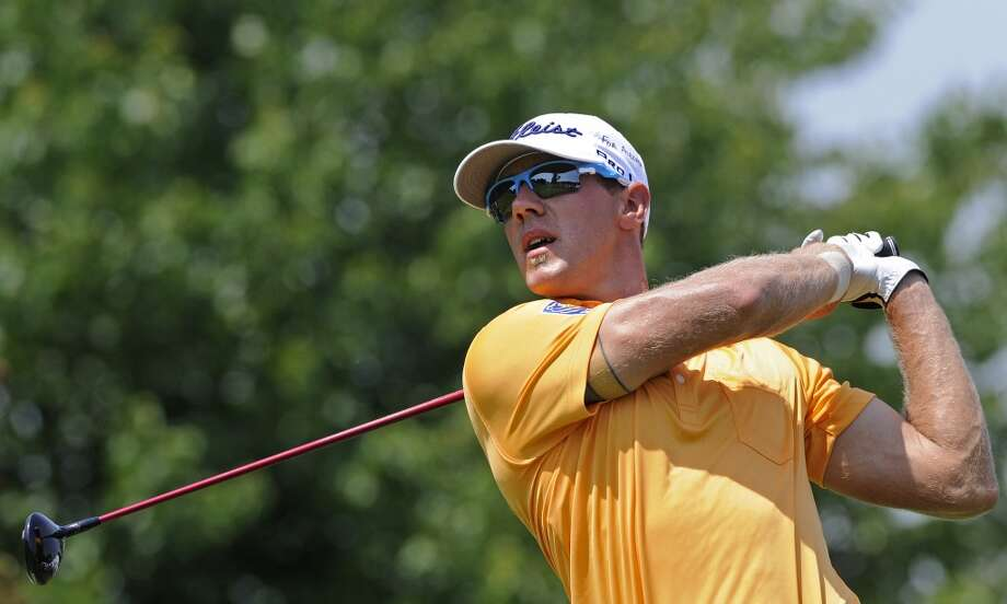 Graham DeLaet, of Canada, tees off on the second hole during the final round of the Travelers Championship golf tournament in Cromwell, Conn., Sunday, June 23, 2013. (AP Photo/Fred Beckham)