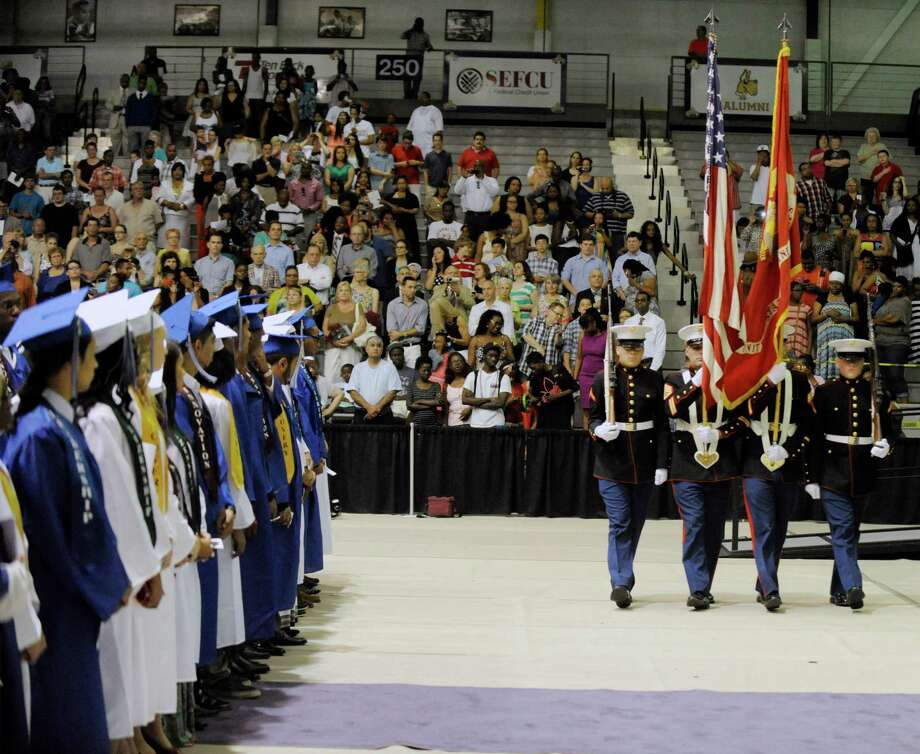 Students stand as the Color Guard arrive's during the Albany High School commencement exercises inside the SEFCU Arena on the University at Albany campus Albany, N.Y., Sunday, June 23, 2013. (Hans Pennink / Special to the Times Union) Photo: Hans Pennink / Hans Pennink