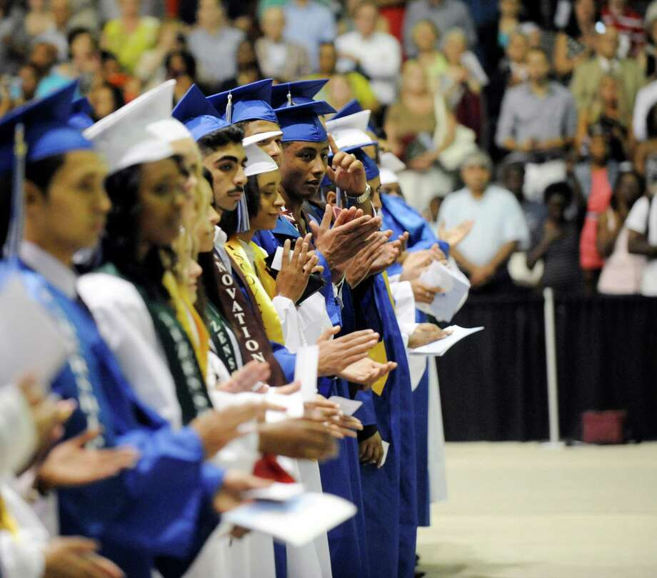 Students applaud speaker's during the Albany High School commencement exercises inside the SEFCU Arena on the University at Albany campus Albany, N.Y., Sunday, June 23, 2013. (Hans Pennink / Special to the Times Union) Photo: Hans Pennink / Hans Pennink