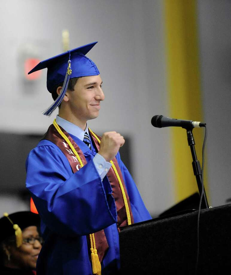 "Hillel Adler pumps his fist as he gives his ""Salutatory Address"" to classmates during the Albany High School commencement exercises inside the SEFCU Arena on the University at Albany campus Albany, N.Y., Sunday, June 23, 2013. (Hans Pennink / Special to the Times Union) Photo: Hans Pennink / Hans Pennink"