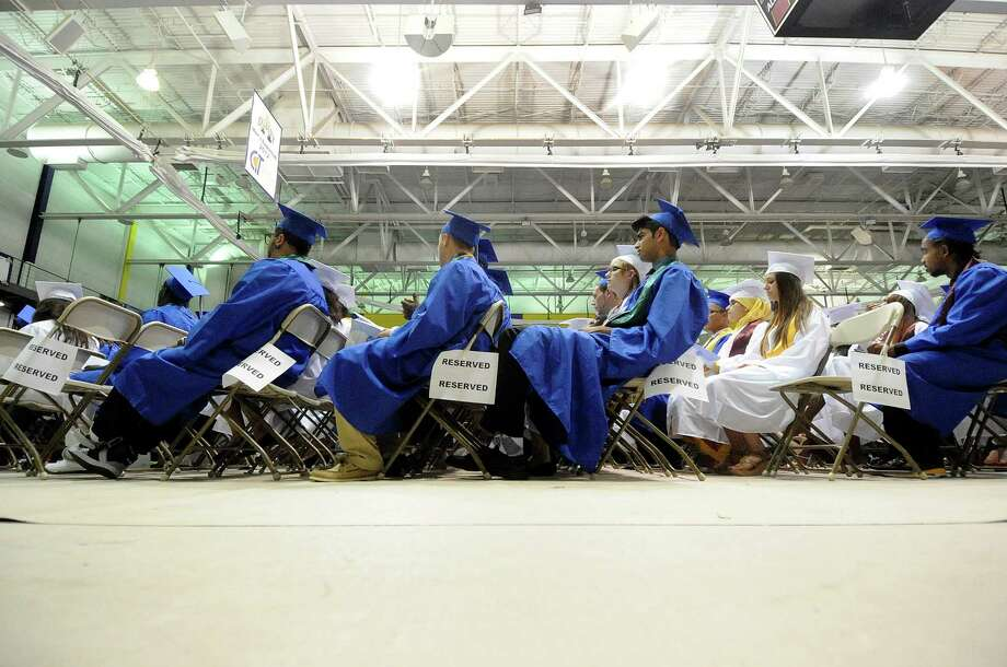 Studnets sit a nd wait during the Albany High School commencement exercises inside the SEFCU Arena on the University at Albany campus Albany, N.Y., Sunday, June 23, 2013. (Hans Pennink / Special to the Times Union) Photo: Hans Pennink / Hans Pennink