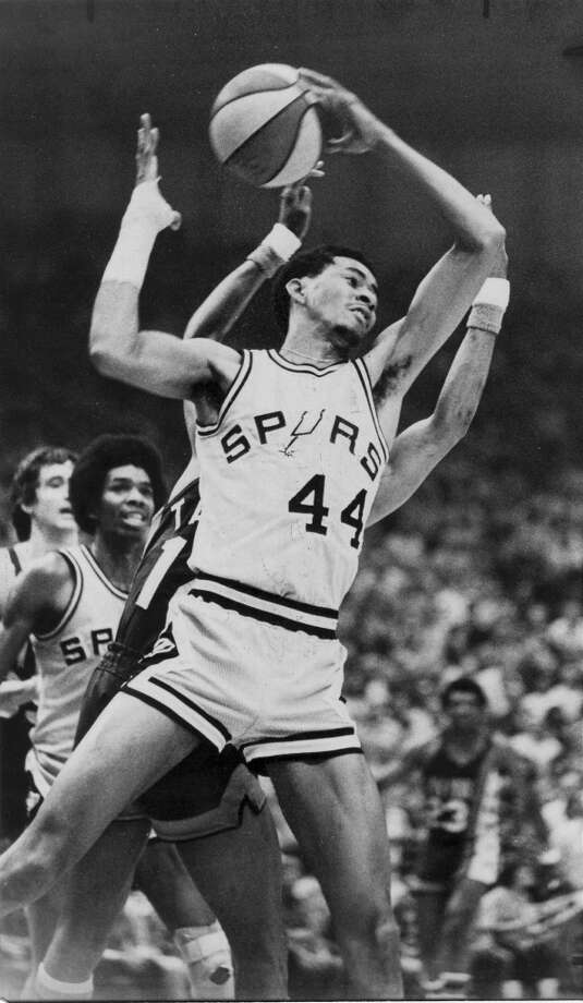 The Spurs' George Gervin grabs a rebound during Game 6 of the ABA semifinal playoff series with the New York Nets on April 21, 1976.
