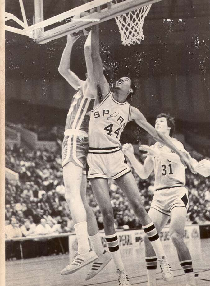 George Gervin and Tom Owens go after a rebound in this undated file photo.