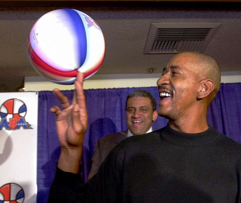 Detroit Dogs coach George Gervin spins a basketball during a news conference in Inglewood, Calif., Thursday, Oct. 5, 2000, where a new men's professional basketball league, ABA 2000, was introduced.