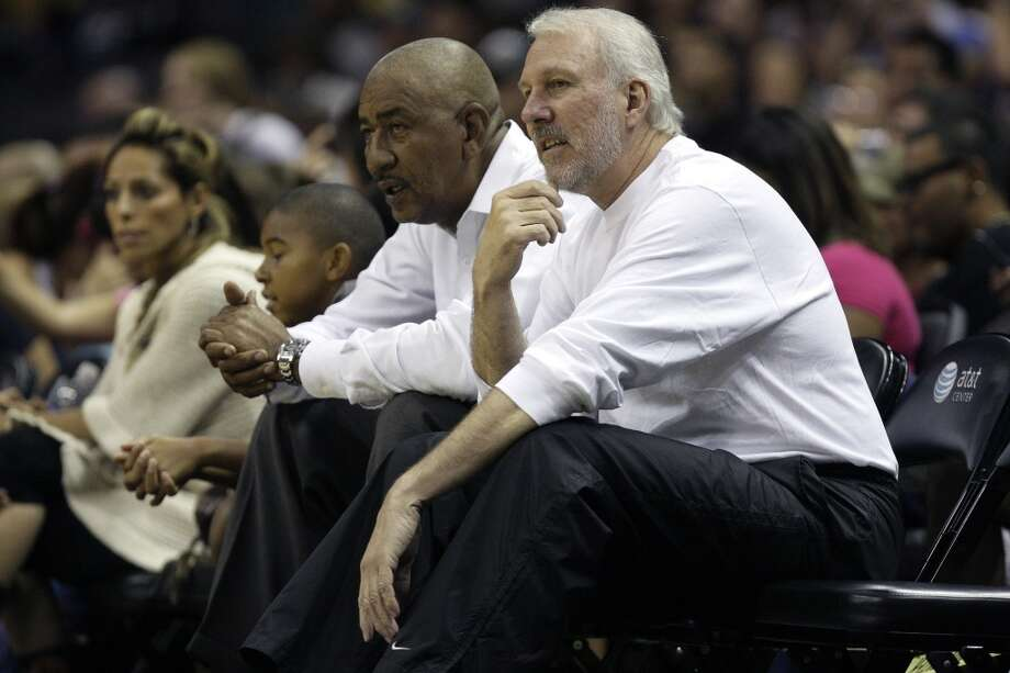 """Spurs coach Gregg Popovich sits with former player George """"Iceman"""" Gervin during a scrimmage at the AT&T Center, Sunday, Oct. 4, 2009."""