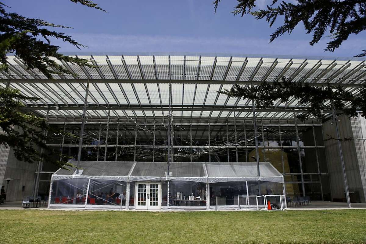 The California Academy of Sciences is currently using a transparent tent to pose as an outdoor cafe area while planning for the dining pavilion in west garden is in the works in San Francisco, Calif. June 18, 2013.