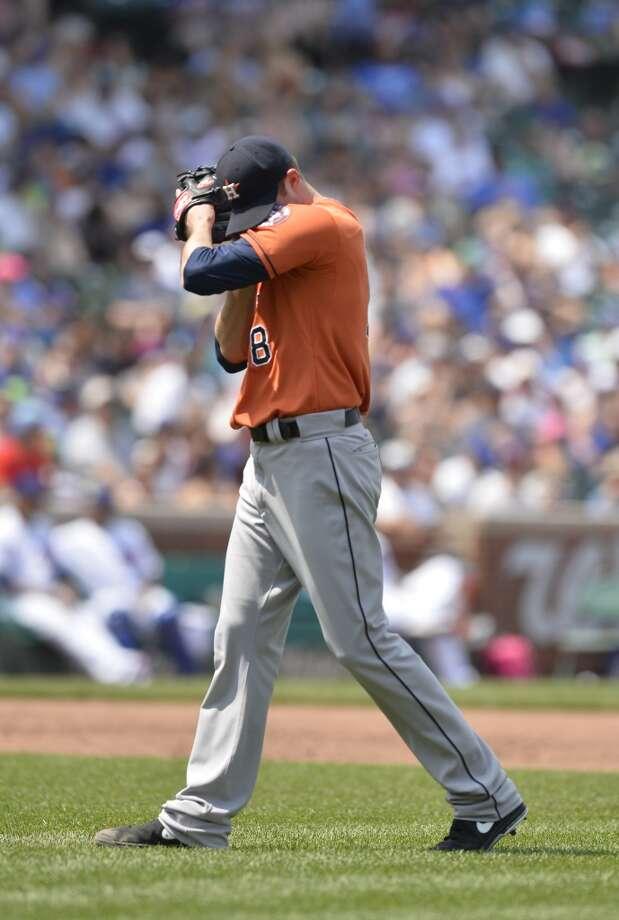 Astros pitcher Jordan Lyles pauses during