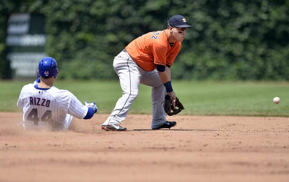Anthony Rizzo of the Cubs slides into second base safely as Marwin Gonzalez of the Astros doesn't get the ball in time.