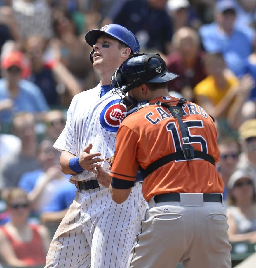 Astros catcher Jason Castro tags out Ryan Sweeney of the Cubs at home plate.
