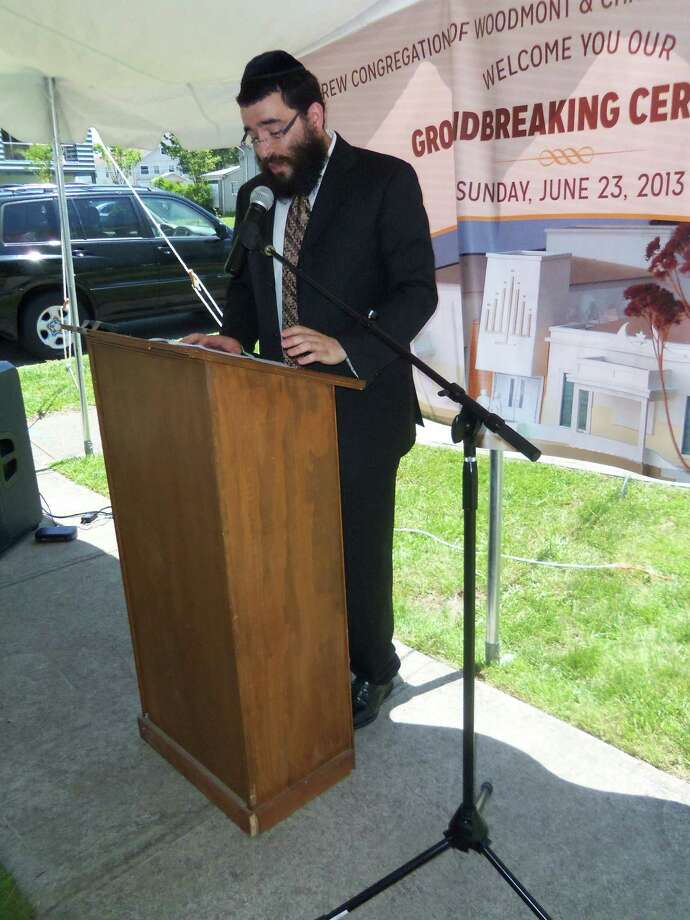 Rabbi Schneur Wilhelm speaks to supporters at the groundbreaking event on Sunday, June 23, 2013, for Hebrew Congregation of Woodmont and the Chabad Jewish Center of Milford which was badly damaged by fire on Oct. 14. Photo: John Burgeson