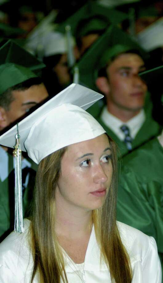 Arielle Barker ponders a speaker's thoughts during New Milford High School's commencement exercises at the O'Neill Center on the campus of Western Connecticut State University in Danbury. June 22, 2013 Photo: Contributed Photo