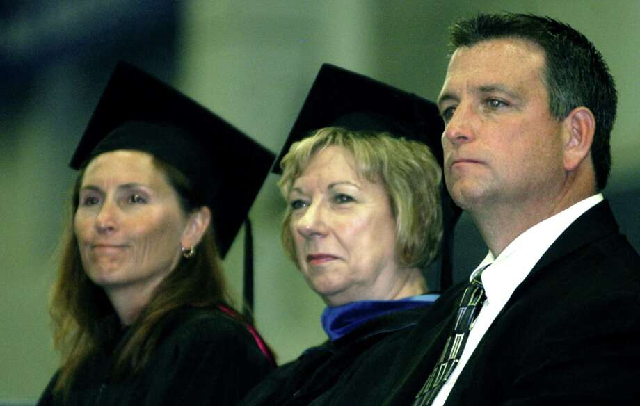 Listening with pride to salutatorian Quentin Leitz' address are Board of Education chairwoman Wendy Faulenbach, left, Superintendent of Schools JeanAnn Paddyfote and NMHS Principal Greg Shugrue during New Milford High School's commencement exercises at the O'Neill Center on the campus of Western Connecticut State University in Danbury. June 22, 2013 Photo: Norm Cummings