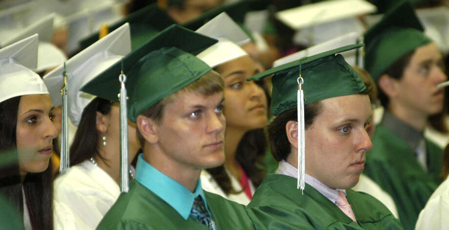 Kameron Bradshaw, left center, listens to a classmate's speech with fellow grads during New Milford High School's commencement exercises at the O'Neill Center on the campus of Western Connecticut State University in Danbury. June 22, 2013 Photo: Norm Cummings