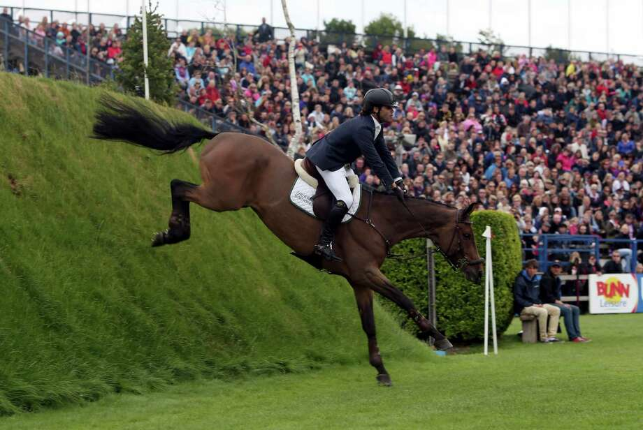 Brazil's Carlos Eduardo Motta Ribas riding Ude, comes down off the Derby Bank during the Hickstead Derby at the The All England Jumping Course, Hickstead, England, Sunday June 23, 2013.  Carlos Eduardo Motta Ribas came off his mount and was taken away for medical treatment with a suspected dislocated shoulder. (AP Photo/Steve Parsons, PA) UNITED KINGDOM OUT - NO SALES - NO ARCHIVES Photo: Steve Parsons