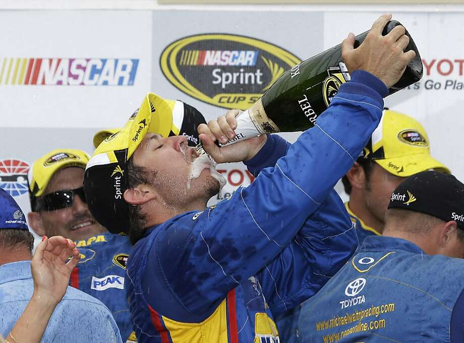 Martin Truex Jr. celebrates after winning the NASCAR Sprint Cup series auto race on Sunday, June 23, 2013, in Sonoma, Calif. (AP Photo/Eric Risberg) Photo: Eric Risberg, Associated Press
