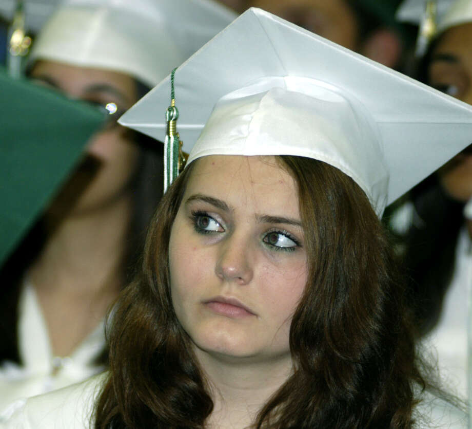 Desirae Bonn listens intently during New Milford High School's commencement exercises at the O'Neill Center on the campus of Western Connecticut State University in Danbury. June 22, 2013 Photo: Norm Cummings