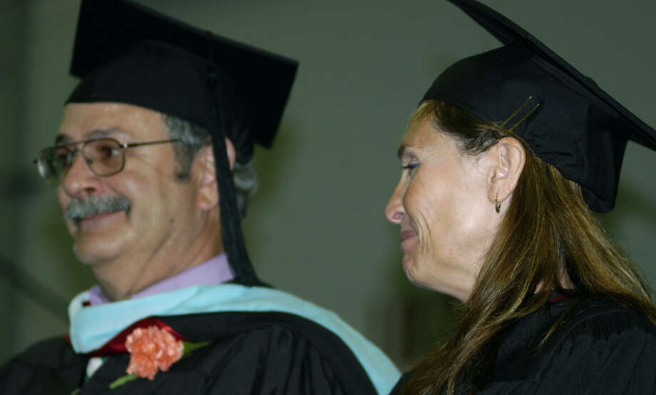 Chairwoman Wendy Faulenbach and member David Lawson of the New Milford Board of Education share a nervous laugh as they prepare to hand out diplomas during New Milford High School's commencement exercises at the O'Neill Center on the campus of Western Connecticut State University in Danbury. June 22, 2013 Photo: Norm Cummings