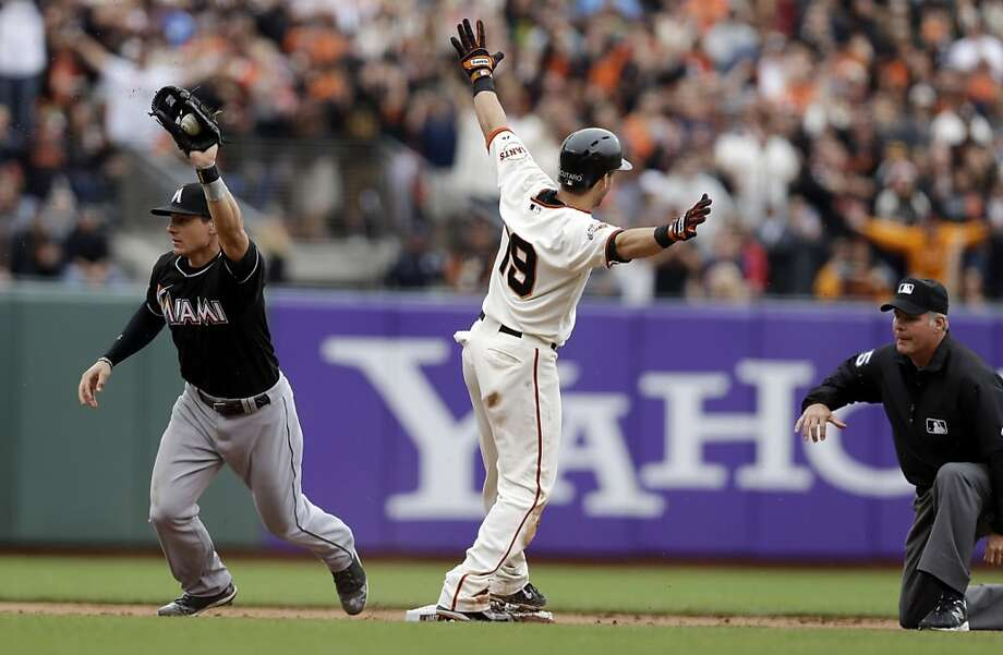 Marco Scutaro's safe call is wishful thinking. In fact, he was thrown out trying to take second on a throw to third after his single in the eighth, with the Giants trailing by a run. Photo: Marcio Jose Sanchez, Associated Press