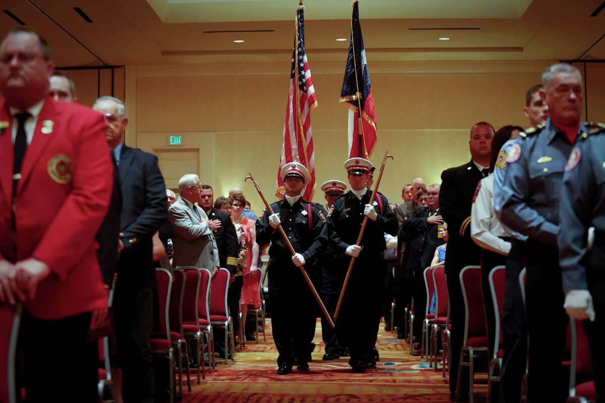 The Montgomery County Fire Chiefs Association Honor Guard presents the American and Texas flags as the State Firemen's and Fire Marshals' Association honored 22 Texas Firefighters who died in the line of duty, including recent Houston firefighters and the volunteer firefighters in West, TX.