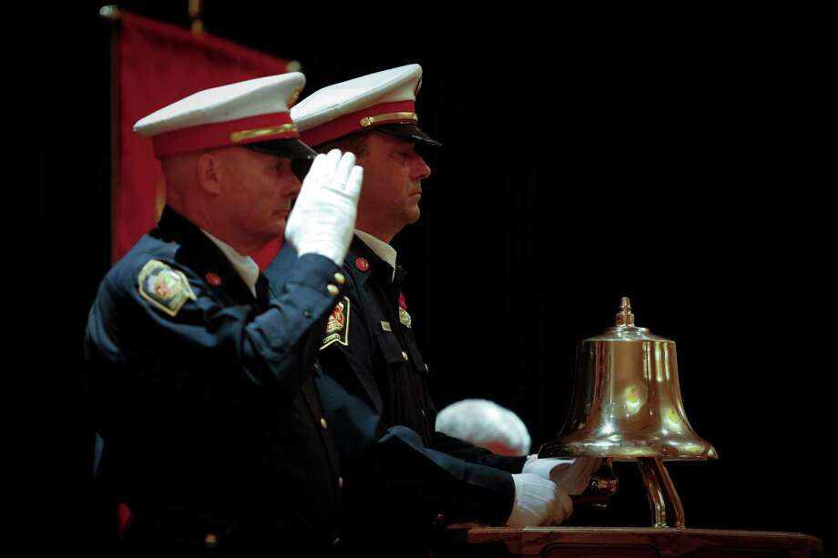The Montgomery County Fire Chiefs Association Honor Guard rings a bell to commemorate firefighters who have died in the line of duty as the State Firemen's and Fire Marshals' Association honored 22 Texas Firefighters who died in the line of duty, including recent Houston firefighters and the volunteer firefighters in West, TX. Photo: Eric Kayne, For The Chronicle / ©Eric Kayne 2013