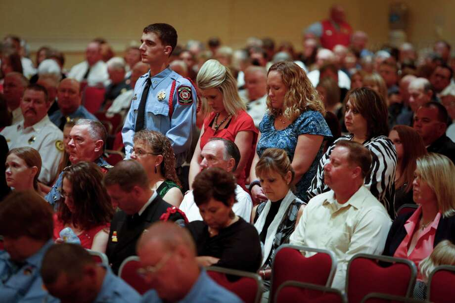 Attendees stand as West Volunteer Fire Department firefighter Joseph Pustejovsky is remembered as the State Firemen's and Fire Marshals' Association honored 22 Texas Firefighters who died in the line of duty, including recent Houston firefighters and the volunteer firefighters in West, TX. Photo: Eric Kayne, For The Chronicle / ©Eric Kayne 2013