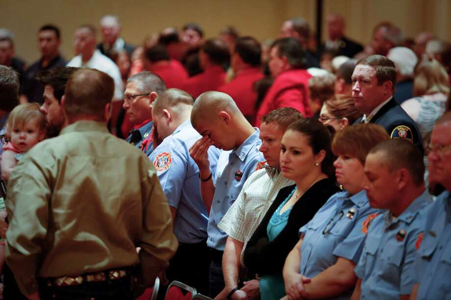Firefighters in attendance listen to Taps as it is played at the State Firemen's and Fire Marshals' Association meeting, which honored 22 Texas Firefighters who died in the line of duty, including recent Houston firefighters and the volunteer firefighters in West, TX. Photo: Eric Kayne, For The Chronicle / ©Eric Kayne 2013