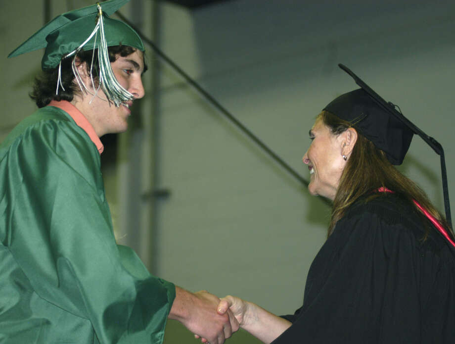 Ian Boisvert receives his diploma from Board of Education chairwoman Wendy Faulenbach during New Milford High School's commencement exercises at the O'Neill Center on the campus of Western Connecticut State University in Danbury. June 22, 2013 Photo: Norm Cummings