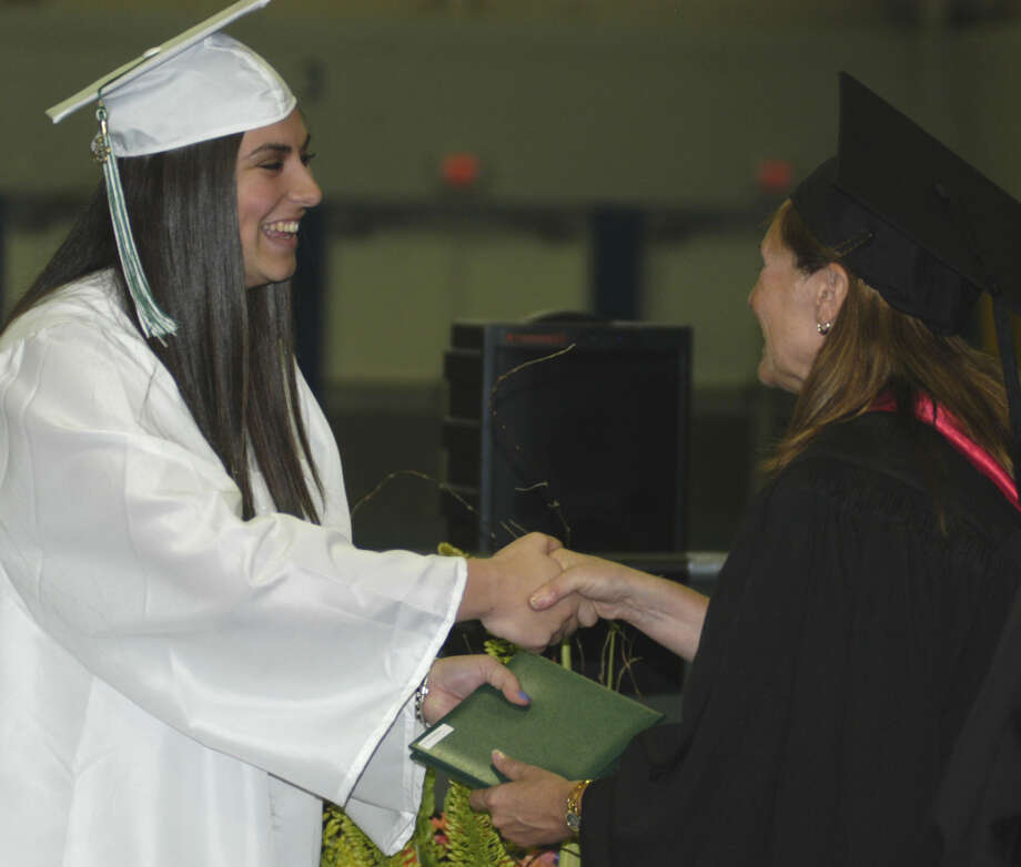 Shannon Cromwell receives her diploma from Board of Education chairwoman Wendy Faulenbach during New Milford High School's commencement exercises at the O'Neill Center on the campus of Western Connecticut State University in Danbury. June 22, 2013 Photo: Norm Cummings