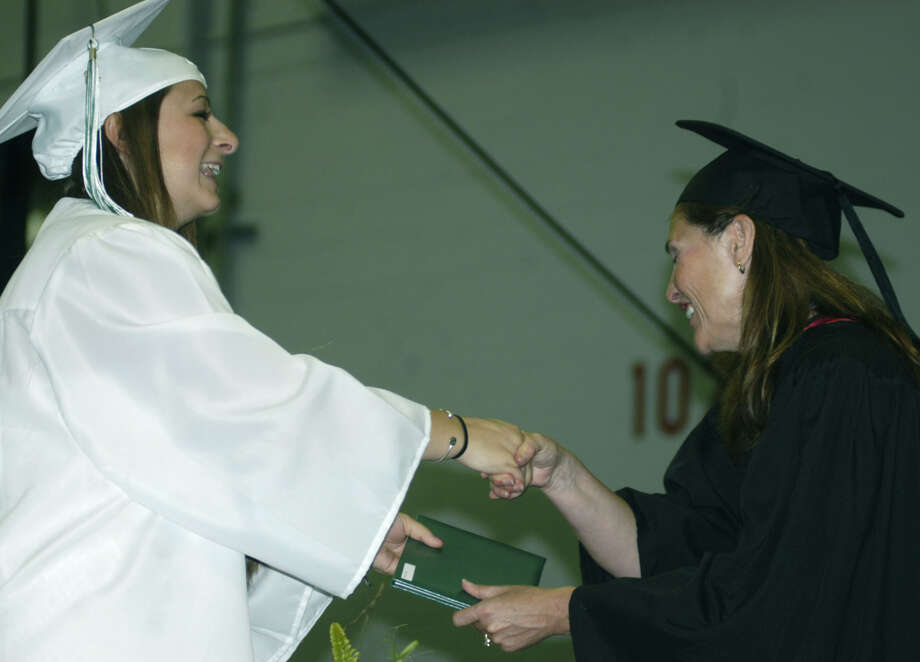 Jenna Caceci receives her diploma from Board of Education chairwoman Wendy Faulenbach during New Milford High School's commencement exercises at the O'Neill Center on the campus of Western Connecticut State University in Danbury. June 22, 2013 Photo: Norm Cummings