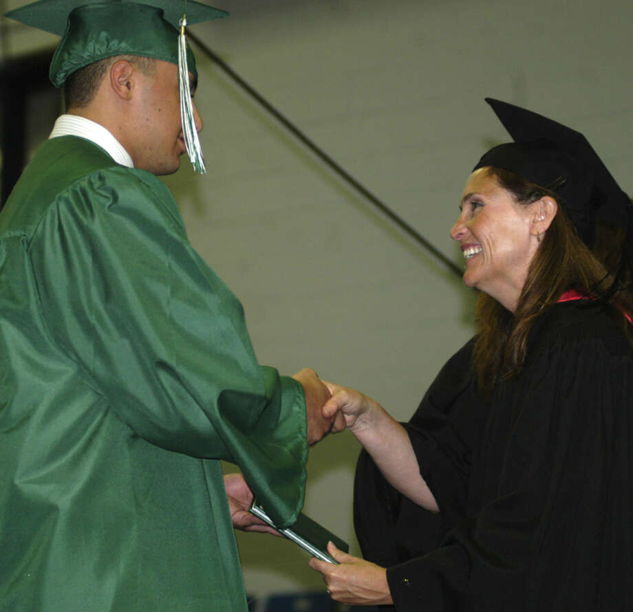 Anthony Capasa receives his diploma from Board of Education chairwoman Wendy Faulenbach during New Milford High School's commencement exercises at the O'Neill Center on the campus of Western Connecticut State University in Danbury. June 22, 2013 Photo: Norm Cummings