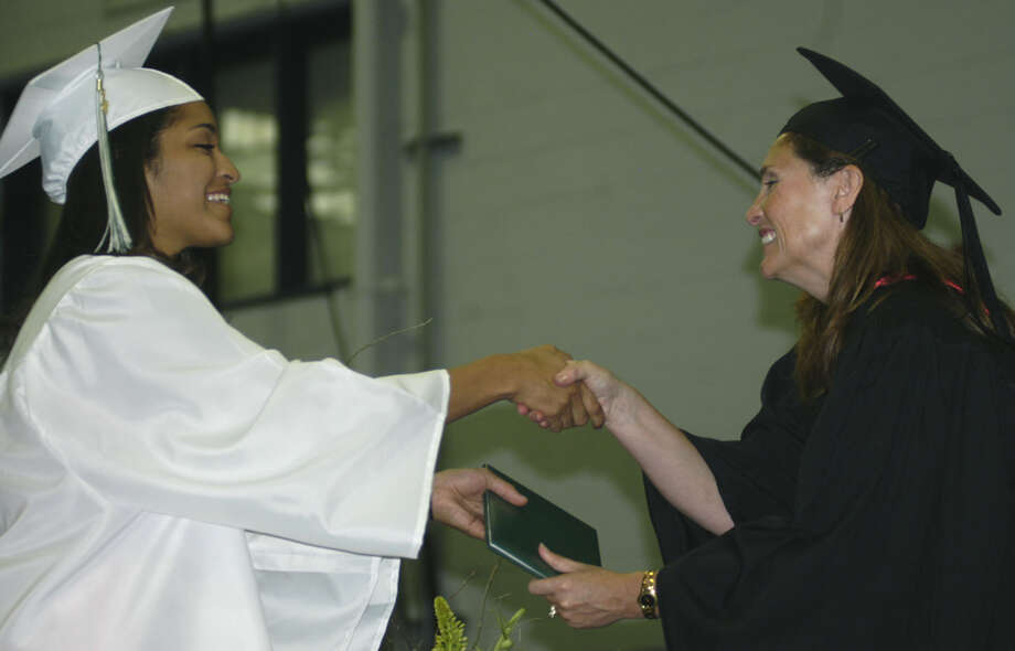 Kayla Carvajal receives her diploma from Board of Education chairwoman Wendy Faulenbach during New Milford High School's commencement exercises at the O'Neill Center on the campus of Western Connecticut State University in Danbury. June 22, 2013 Photo: Norm Cummings