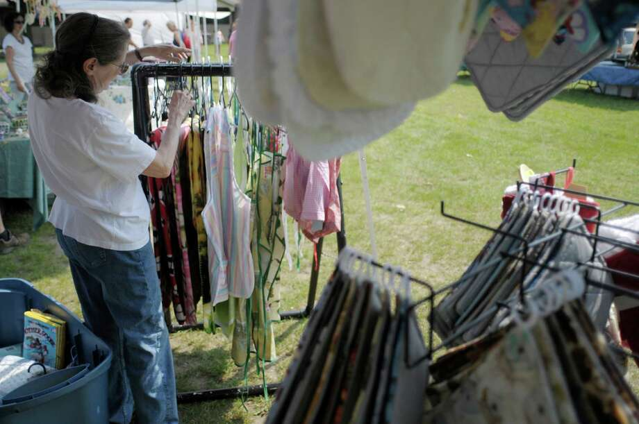 Vendor Mary Sager from Nassau, owner of Remember Them, sets up her booth at the  farmers market at the Italian American Community Center on Washington Ave. Extension on Sunday, June 23, 2013 in Guilderland, NY.  Sager hand makes her items including heritage bears which are teddy bears she makes out of clothing from loved ones who have passed away.   This is the second year that the center has held a summer farmers market on Sundays.  The market consists of vendors selling handmade crafts, fresh farm produce, baked goods, food ready to eat or to take home, cut flowers, plants and more.  The market is every Sunday from 10am to 2pm, through Sept. 29th.  On Sept. 22nd the center will hold its fall festival along with the farmers market.   (Paul Buckowski / Times Union) Photo: Paul Buckowski
