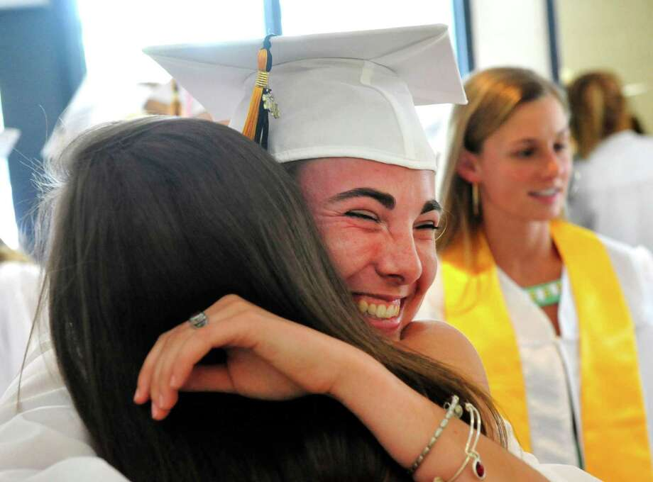 Gabrielle Fignar hugs a friend as Joel Barlow High School Class of 2013 holds commencement ceremonies at the O'Neill Center, on the campus of Western Connecticut State University, in Danbury, Conn. Sunday, June 23, 2013. Photo: Michael Duffy / The News-Times